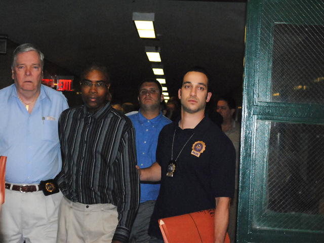 Edwin Whittaker walks into court Monday August 20, 2012 escorted by police officers.