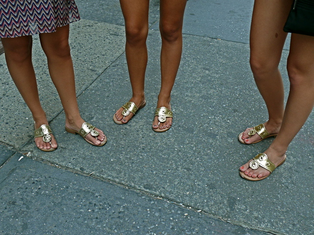 Popular gold summer sandals hit the streets of SoHo.