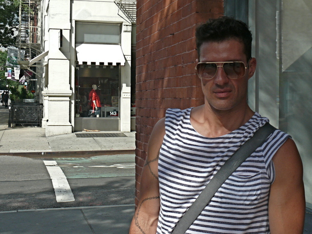Woodrow Monteiro in a bold summer stripe T-shirt in Soho.