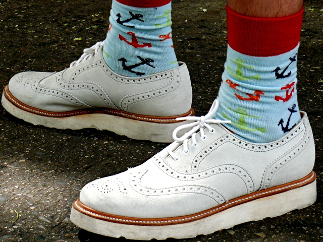 Nautical print socks and white wing-tip shoes on LaGuardia Place.