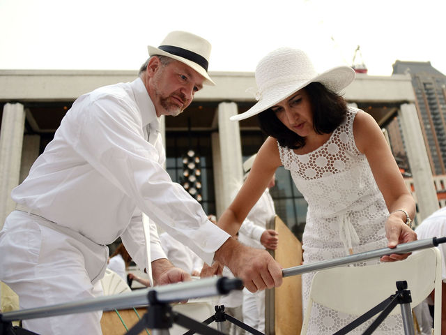Diners setting up at Lincoln Center for New York's second annual Diner en Blanc, Monday, August 20, 2012.