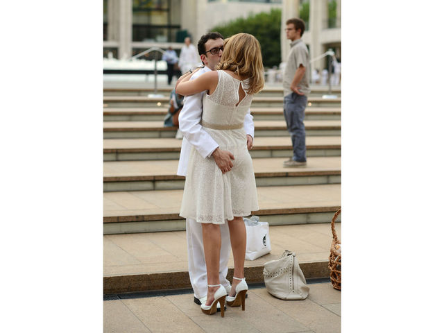 An amorous couple at Lincoln Center for New York's second annual Diner en Blanc, Monday, August 20, 2012.