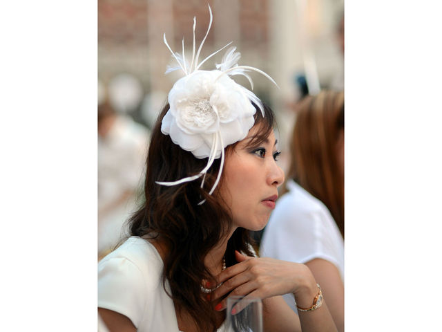 Hats were di rigueur at Lincoln Center for New York's second annual Diner en Blanc, Monday, August 20, 2012.