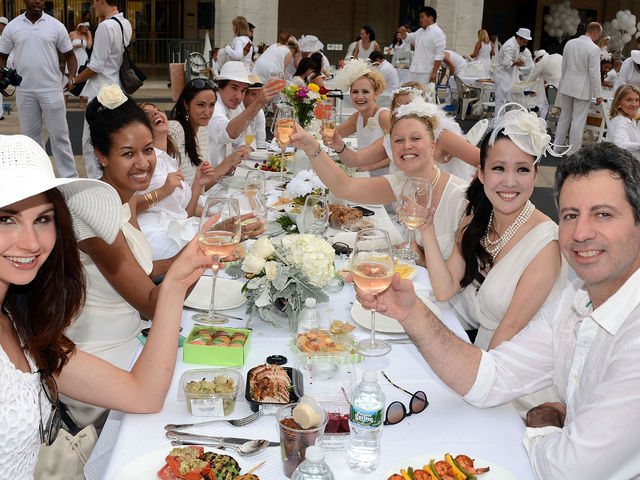 A toast at Lincoln Center for New York's second annual Diner en Blanc, Monday, August 20, 2012.