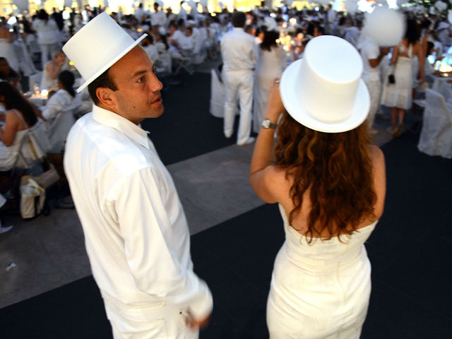 Tops hats were not required, but appreciated at Lincoln Center for New York's second annual Diner en Blanc, Monday, August 20, 2012.