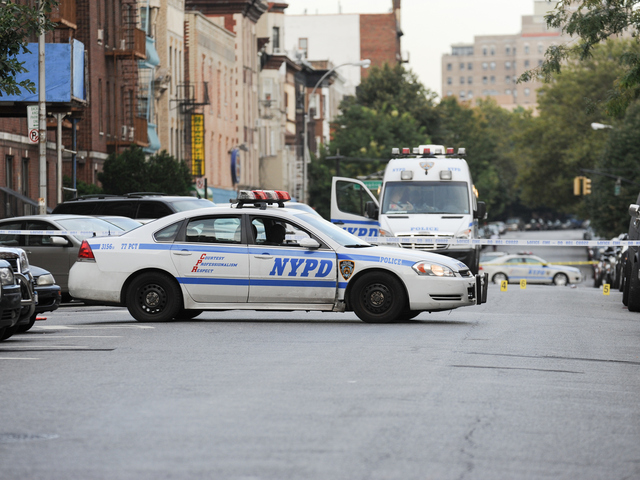 <p>Police at the scene on Saint Marks Avenue where a 17-year-old Darius Robinson was fatally shot on Tuesday August 21st, 2012.</p>