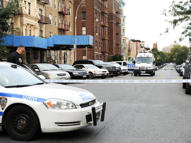 <p>Police at the scene on Saint Marks Avenue where 17 year-old Darius Robinson was fatally shot on Tuesday August 21st, 2012.</p>