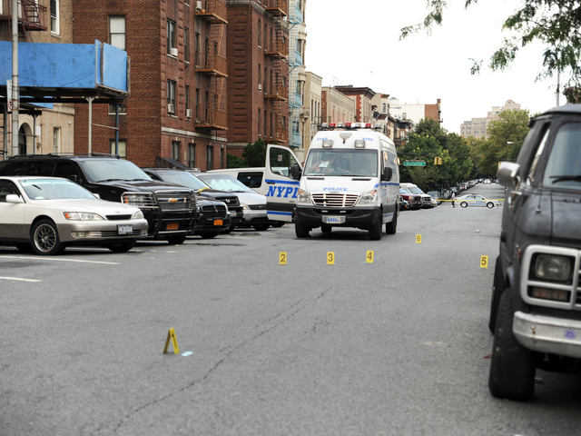 <p>Evidence at the scene where Darius Robinson, 17, was shot and killed on Tuesday August 21st, 2012.</p>