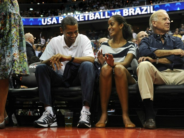 President Barack Obama shares a moment with his daughter Malia, as the U.S. Senior Men's National Team and Brazil play during a pre-Olympic exhibition basketball game at the Verizon Center on July 16, 2012 in Washington, DC.