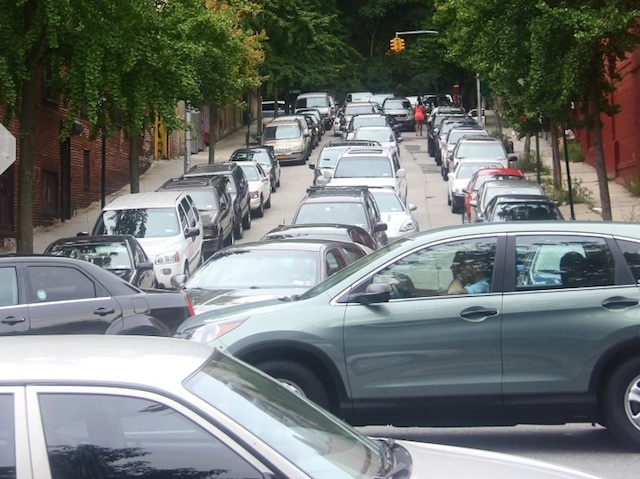 A Local resident snaps a picture of congested traffic on Dyckman street on Sunday, Aug. 19, near the popular La Marina restaurant.