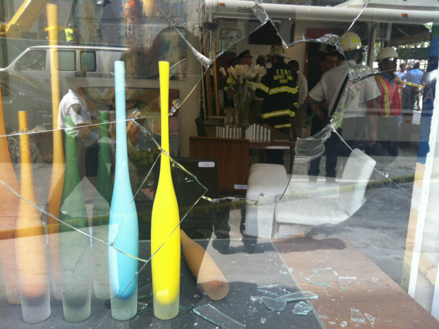 Windows in the storefront of the Kolb Art Gallery were broken after blasting underneath Second Avenue shook the area.