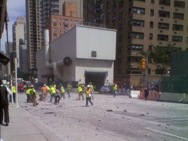 Construction workers cleaned up rubble at East 72nd Street and Second Avenue after a blast went awry Aug. 21, 2012.