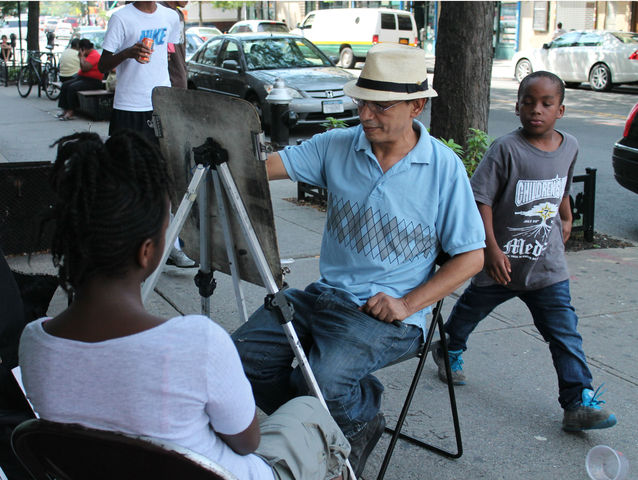 August 21, 2012 - Artist Wally Abdellatif draws 13-year-old, Jordan McNeil's portrait on Myrtle Avenue.