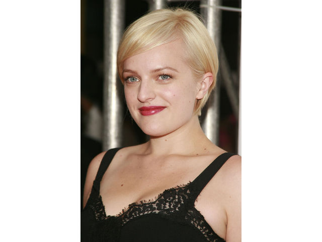 The newly platinum blonde Elisabeth Moss at