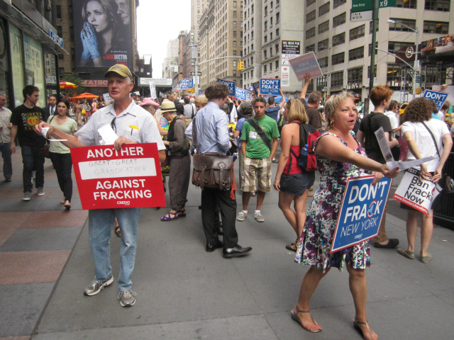 Dozens of protesters gathered at corner of West 53rd Street and Seventh Avenue on Wednesday, Aug. 22, 2012, to protest fracking.