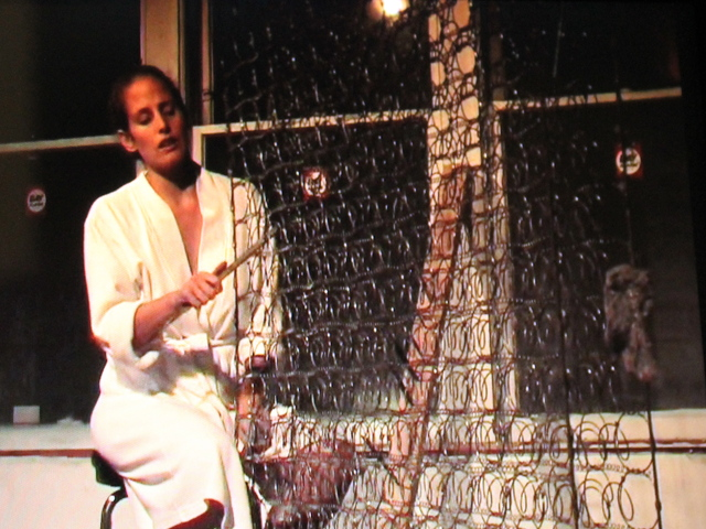 Lital Dotan performed with a nail file and springs of a bed, while her artistic partner (and husband) filmed her. The video installation is among many in their Williamsburg apartment.