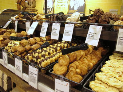 <p>A front counter was filled with cookies as shoppers poured into the new Whole Foods on East 57th Street on Thursday, Aug. 23, 2012.</p>