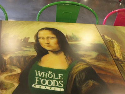 Students from the High School of Art and Design created paintings that adorn the tables at the Whole Foods cafe. The paintings all add Whole Foods-inspired touches to famous works of art.