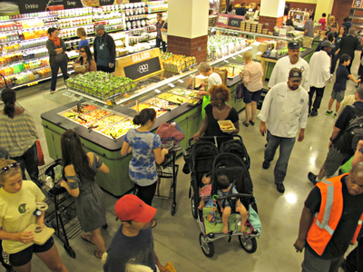 <p>Shoppers swarmed the new Whole Foods on East 57th Street, which opened on Thursday, Aug. 23, 2012.</p>