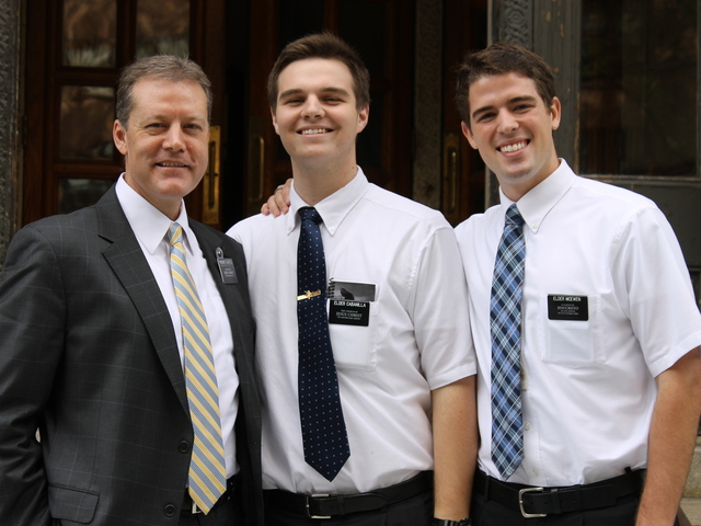 Kevin Calderwood, President of the area's mission, stood outside the Williamsburg church with missionaries Marc Cabanilla and Elder McEwen.