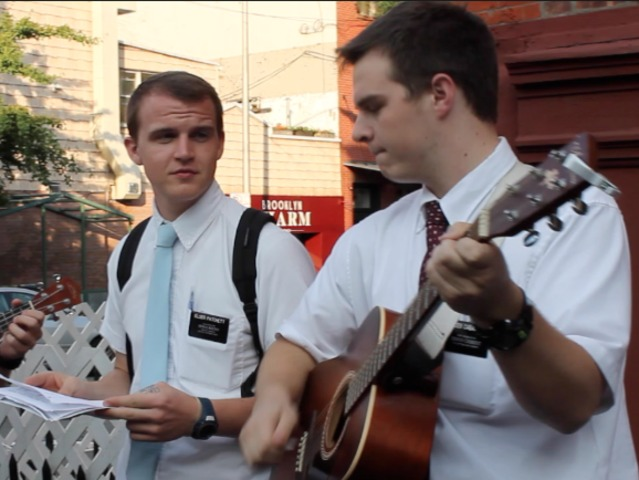 Marc Cabanilla played guitar to lead his group of dozen missionaries in song on Bedford Avenue and North Ninth Street one recent evening. The young men have started performing regularly on Bedford Avenue.