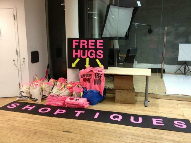 Shoptiques.com posted a photo to its Facebook page of the preparation for the free hug event on Friday, Aug. 24, 2012.
