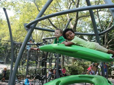 Kids enjoy the new Neufeld Playground, complete with plenty of climbing spaces.