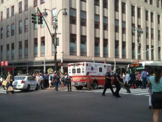 Emergency responders at the scene of a shooting at the Empire State Building Friday morning.