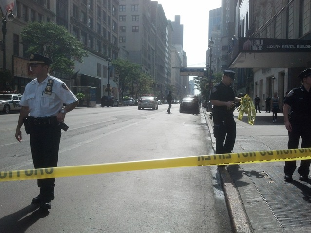 Police blanket the scene of a shooting near the Empire State Building, Aug. 24, 2012.