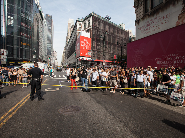 Crowds gather at Herald Square close to the scene of the Empire State Building shooting on Aug. 24th, 2012.