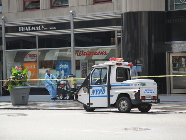 NYPD's cleaning crew clean blood spatter off the sidewalks of Fifth Avenue from the Empire State Building shooting.