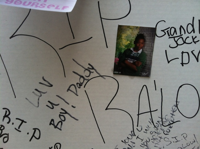 A photo stuck to a shrine set up for Ronald Wallace, 13, who was shot on August 24, 2012.