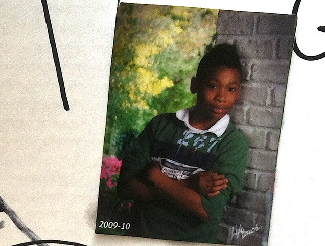 A photo of Ronald Wallace, 13, taken in 2009, that hung on a shrine set up after he was fatally shot August 24, 2012.