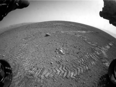 IN SPACE - AUGUST 22: In this handout provided by NASA/JPL-Caltech, tracks from NASA's Curiosity Mars rover are seen August 22, 2012 on Mars. According to NASA, the rover moved forward 15 feet, then rotated 120 degrees before reversing 8.2 feet during its first time moving.