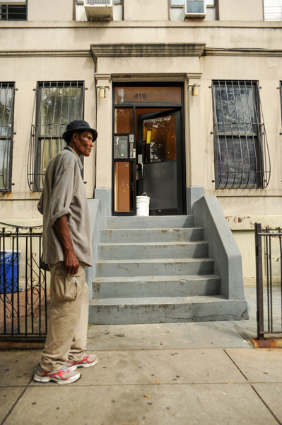 A resident stands outside of 419 Chauncey Street where a man allegedly stabbed several members of his family on Tuesday August 28th, 2012.