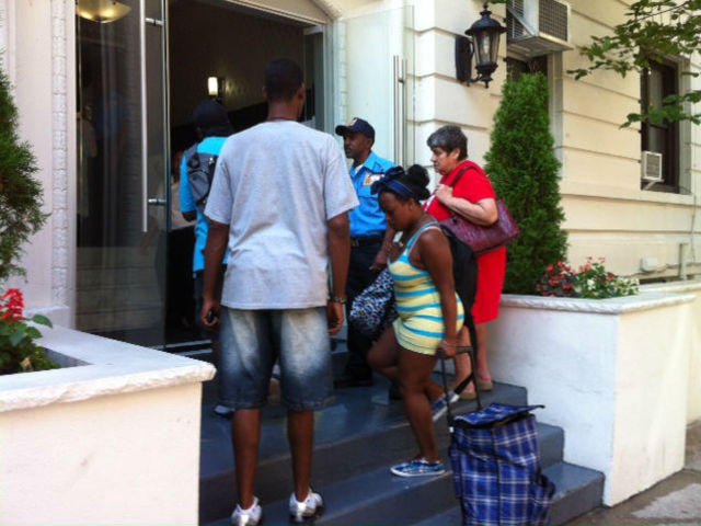 Residents return to the building after being evacuated after a mattress fire Tuesday morning.