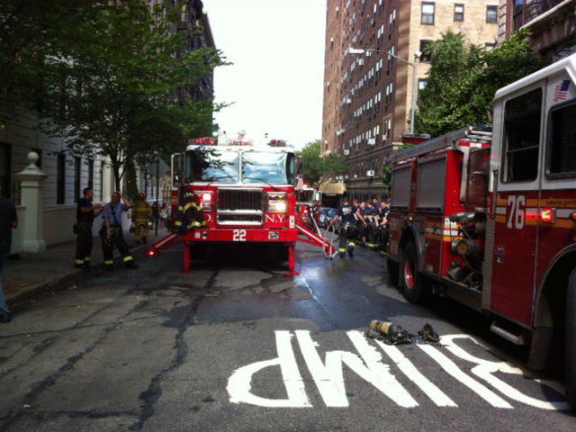 Fire trucks arrive at West 95th Street after a small bedroom fire broke out.