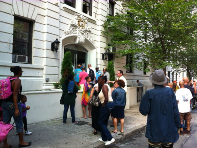 Residents assembled outside their building after being evacuated after a fire began inside.