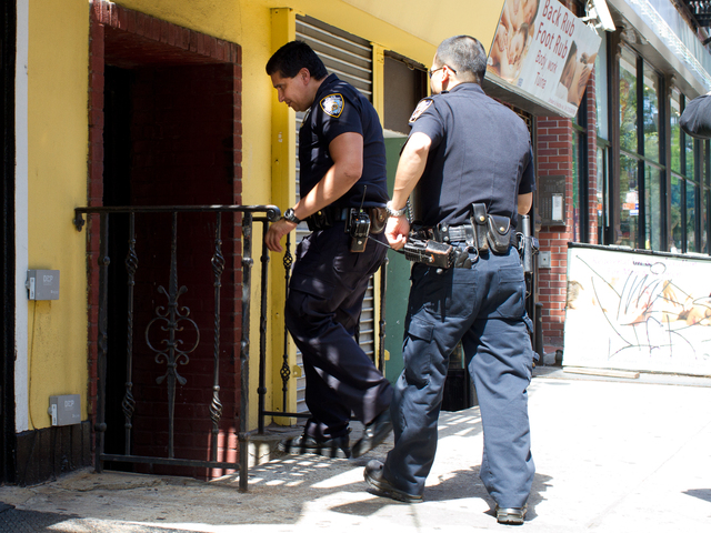 Police enter 191 Orchard St. Tuesday Aug. 28, 2012, where Carlisle Brigham was found bleeding at the bottom of the stairs.