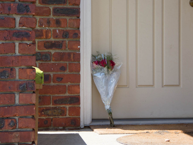 Family left flowers on the front porch of David Restuccio's Meiers Corners home. The former FDNY EMS driver was in a fatal car crash on Mondy, August 28, 2012.
