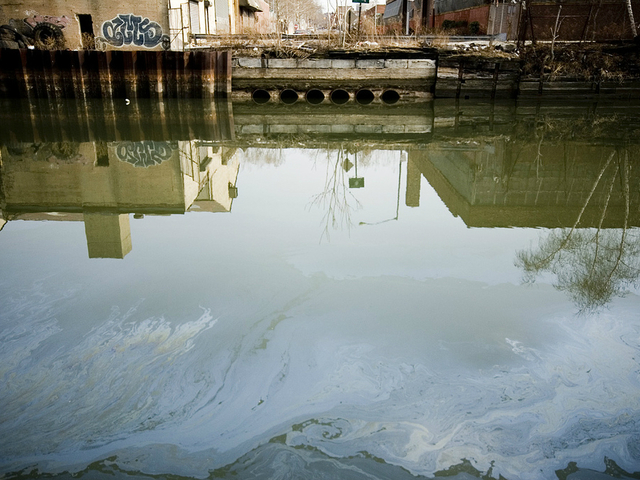 <p>Pollution is visible on the surface of the Gowanus Canal, and can also be found below in the sediment.</p>