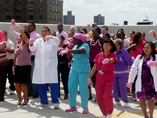 Staff members at St. Barnabas Hospital in the Bronx performed a flash mob dance on the roof of the hospital's parking garage Tuesday as part of the Pink Glove Dance Competition--a national video contest to promote breast cancer awareness.