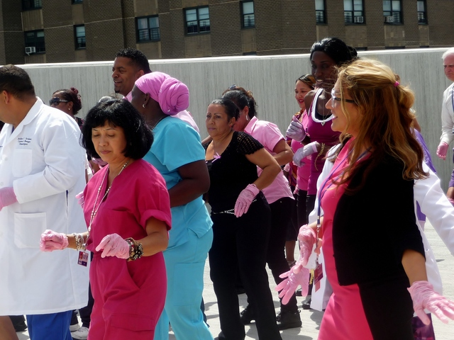 St. Barnabas Hospital staff competes in the Pink Glove Dance Competition. The Pink Glove Dance phenomenon started three years ago, when the medical product manufacturer Medline launched a line of pink vinyl gloves to help promote breast cancer awareness.