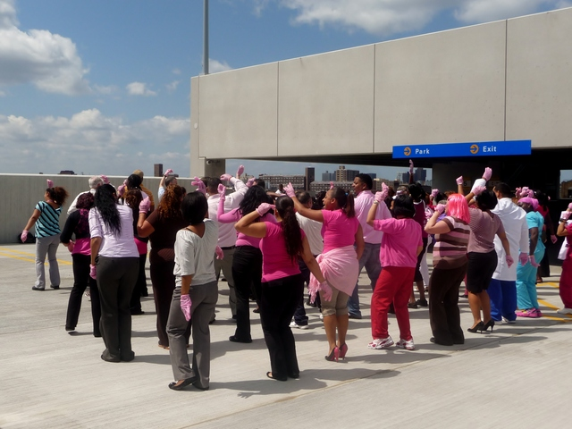 St. Barnabas Hospital staff competes in the Pink Glove Dance Competition. The winning Pink Glove video will receive $10,000 to donate to the breast cancer charity of the organization's choice.