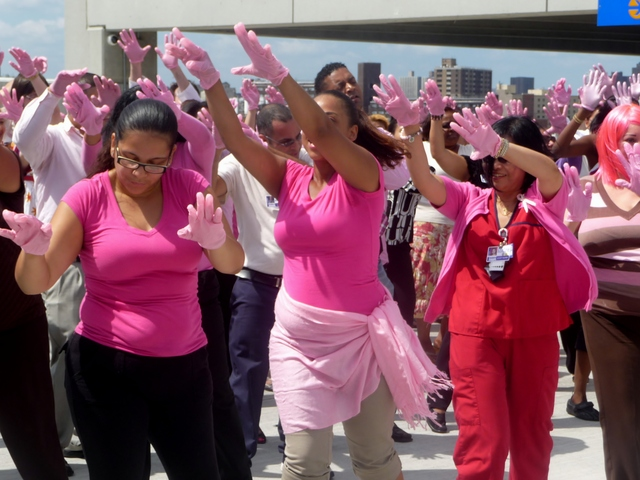 St. Barnabas Hospital staff competes in the Pink Glove Dance Competition. Hundreds of hospital workers participated in the different video shoots for the project, which will be edited together and submitted online by the end of September.