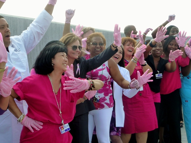 St. Barnabas Hospital staff competes in the Pink Glove Dance Competition on Tuesday, August 28, to promote breast cancer awareness.