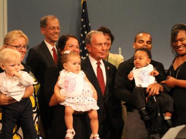 Mayor Bloomberg stands with 11-month-olds Gunar Hackemberg, Isabella Pal and Jayden Marthone inside City Hall.