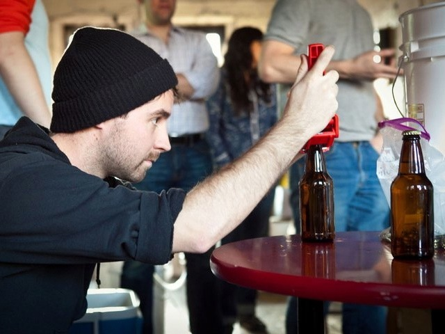 A student bottles beer at Bitter and Esters.