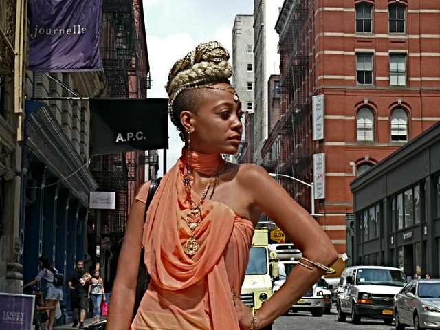 Draped fabric, gold, stone and pearl jewelry worn by photographer and designer Reign Apiim in SoHo.