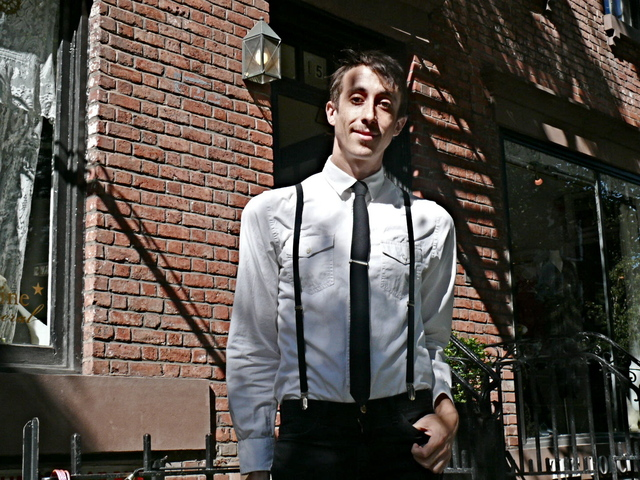 Suspenders and a tie worn with a military-style shirt by Craig Cady on Christopher Street.